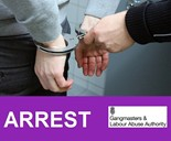 handcuffs on pair of hands arrest gangmasters and labour abuse authority