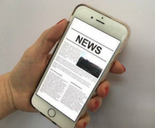 GLAA Female hand holding phone displaying news 155x128px