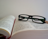 reading glasses on open text book