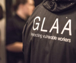 A close up of the GLAA branding on a GLAA worker's jacket