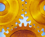 Cogs gold blue background 155x128px