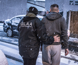 GLAA officer making an arrest in snow Liverpool
